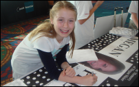 Photograph: A Tweenangel Signing a Megan Pledge Banner